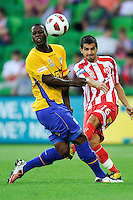 MELBOURNE, AUSTRALIA - JANUARY 09: Bruce Djite of United and Aziz Behich of the Heart compete for the ball during the round 23 A-League match between the Melbourne Heart and Gold Coast United at AAMI Park on January 19, 2011 in Melbourne, Australia. (Photo by Sydney Low / Asterisk Images)