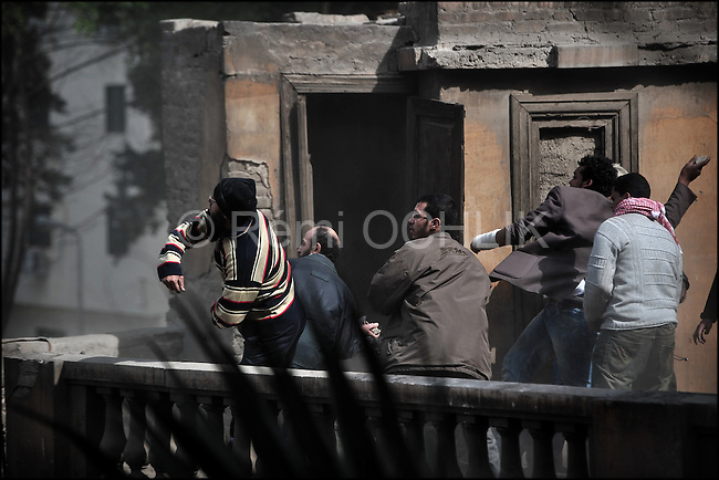 © Remi OCHLIK/IP3 - Cairo Feb. 03 -- Tahrir Square . Young anti mubarak Egyptians throw stones to the pro Mubarak. During the night they d set up barricades to protect the square from the pros...Chaos intensifies, violence spreads. Protesters and regime supporters fought in a second day of rock-throwing battles at a central Cairo square while new lawlessness spread around the city. New looting and arson erupted, and gangs of thugs supporting President Hosni Mubarak attacked reporters, foreigners and rights workers while the army rounded up foreign journalists. As bruised and bandaged protesters danced in victory after forcing back Mubarak loyalists attacking Tahrir Square, the government increasingly spread an image that foreigners were fueling the turmoil and supporting the unprecedented wave of demonstrations demanding the ouster of Mubarak, this country's unquestioned ruler for nearly three decades.
