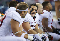 SEATTLE, WA - September 28, 2013: Stanford defensive tackle David Parry talks with teammates on the bench during play against Washington State at CenturyLink Field. Stanford won 55-17