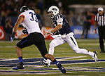 Boise State defender Gabe Perez (33)  pursues Nevada quarterback Cody Fajardo (17) during the first half of an NCAA college football game in Reno, Nev., on Saturday, Oct. 4, 2014. Boise State won 51-46. (AP Photo/Cathleen Allison)