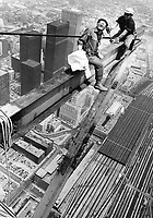 1974 FILE PHOTO -<br /> <br /> Workmen erecting the steel base for the new Top of Toronto restaurant at the Sky Pod level last year grinned back at photographer Spremo balanced on a steel girder just above them. Said Spremo: Standing there; shooting out into space; felt rather like flying a plane without any wings