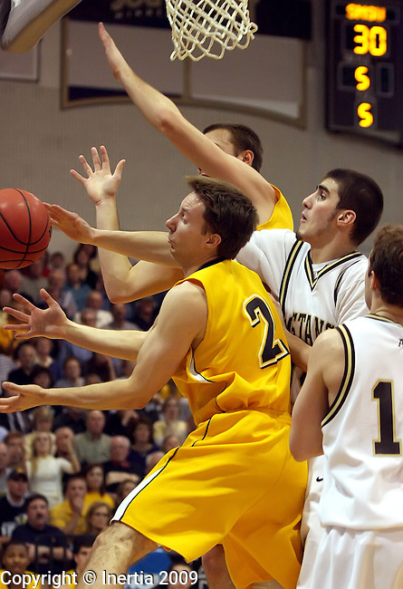 MARSHALL, MN - MARCH 17: Scott Rohl #34 of Southwest Minnesota State battles for a rebound with Marques Blank #2 and Derrick DeZeeuw #33 of Augustana in the first half during the NCAA Central Region Tournament Championship Tuesday night at the R/A Facility in Marshall, MN. (Photo by Dave Eggen/Inertia)