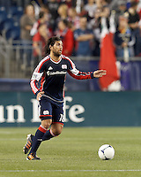 New England Revolution substitute midfielder Juan Toja (18) brings the ball forward. Despite a red-card man advantage, in a Major League Soccer (MLS) match, the New England Revolution tied New York Red Bulls, 1-1, at Gillette Stadium on September 22, 2012.