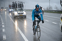 after putting on a rain jacket, Sir Bradley Wiggins (GBR/Sky) is riding his way through the teamcar-convoy back to the peloton<br /> <br /> 77th Gent-Wevelgem 2015