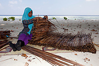 Woman, inhabitan of a remote island at work, Maldives, Indian Ocean