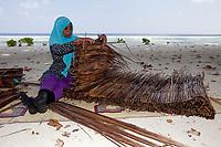 Woman, inhabitan of a remote island at work, Maldives, Indian Ocean