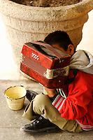 Boy with accordion; Progreso, Mexico; 1152am, 7Dec2005