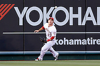 Mike Trout #27 of the Los Angeles Angels chases down a ball that hit the wall during a game against the Kansas City Royals at Angel Stadium on May 14, 2013 in Anaheim, California. (Larry Goren/Four Seam Images)