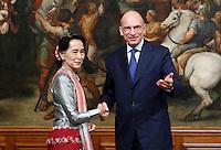 L'attivista birmana e vincitrice del Premio Nobel per la Pace Aung San Suu Kyi stringe la mano al Presidente del Consiglio Enrico Letta, a destra, a Palazzo Chigi, Roma, 28 ottobre 2013.<br /> Burmese opposition leader and Nobel Prize laureate Aung San Suu Kyi shakes hands with Italian Premier Enrico Letta, right, at Chigi Palace, Rome, 28 October 2013.<br /> UPDATE IMAGES PRESS/Isabella Bonotto