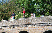 SIDCUP, KENT, ENGLAND - 21 MAY 2020<br /> .<br /> Children jumping off the bridge while enjoy the hot weather during the current government restricted lockdown of the COVID-19 worldwide pandemic with includes keeping a social distance of 2 metres at Foots Cray Meadow, Sidcup, England on 21 May 2020. Photo by Alan Stanford.