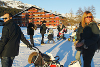 Switzerland. Valais. Crans Montana. Winter ski resort. Italian families and children on the golf course on a sunny day with blue sky. © 2005 Didier Ruef