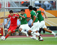 Yahya Golmohammadi of Iran tries to escape from Carlos Salcido of Mexico. Mexico defeated Iran 3-1 during a World Cup Group D match at Franken-Stadion, Nuremberg, Germany on Sunday June 11, 2006.