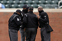 CHAPEL HILL, NC - FEBRUARY 27: Umpires Linus Baker, Damien Beal, Randy Watkins, and Greg Street, the first all-black crew to officiate an NCAA or MLB game, huddle to discuss a call during a game between Virginia and North Carolina at Boshamer Stadium on February 27, 2021 in Chapel Hill, North Carolina.