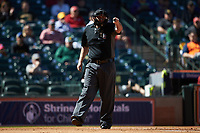 Home plate umpire Ron Teague asks for help from the first base umpire during the NCAA baseball game between the Missouri Tigers and the Baylor Bears in game one of the 2020 Shriners Hospitals for Children College Classic at Minute Maid Park on February 28, 2020 in Houston, Texas. The Bears defeated the Tigers 4-2. (Brian Westerholt/Four Seam Images)