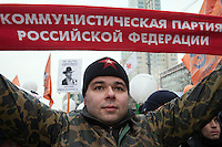 Moscow, Russia, 24/12/2011..A demonstrator waves a Russian Communist Party scarf in front of a poster of US action movie actor Chuck Norris. An estimated crowd of up to 100,000 gather for a protest against election fraud and Prime Minister Vladimir Putin in the largest anti-government demonstration in Russia since the collapse of the Soviet Union.