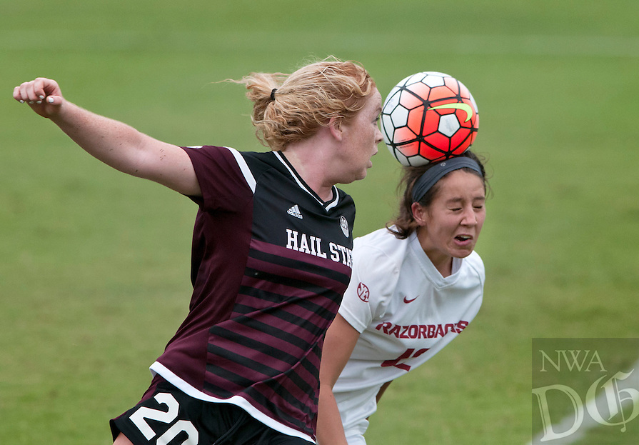 NWA Democrat-Gazette/BEN GOFF @NWABENGOFF<br /> Claire Kelley (right) of Arkansas wins a header over Red Bruffett of Mississippi State in the second half on Sunday Sept. 20, 2015 during the match at Razorback Field in Fayetteville.