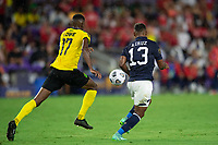 ORLANDO, FL - JULY 20: Damion Lowe #17 of Jamaica and Allan Cruz #13 of Costa Rica battle for the ball during a game between Costa Rica and Jamaica at Exploria Stadium on July 20, 2021 in Orlando, Florida.