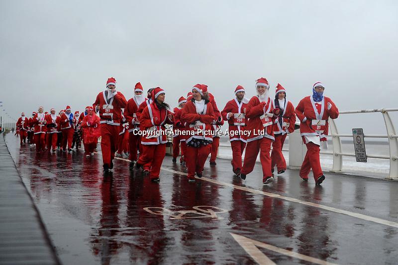Pictured: Runners in Santa Claus fancy dress during this year's run in Aberavon, Wales, UK. Saturday 15 December 2018<br /> Re: 500 people have taken part in Run4All Santa 5km Run on Aberavon Promenade near Port Talbot, Wales, UK.