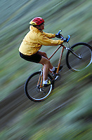 Woman mountain biking, blurred motion, Colorado. Susie Sutphin (MR 658). Colorado.
