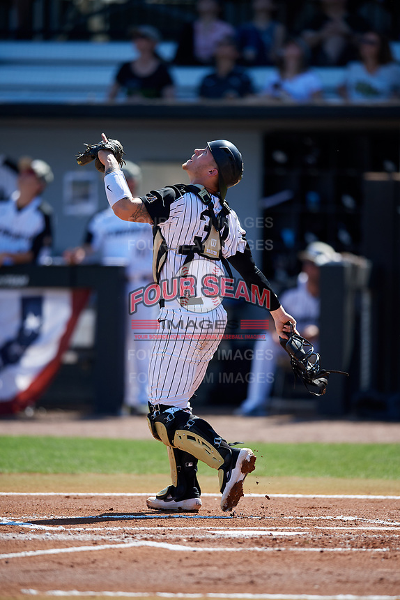 UCF Knights catcher Jordan Rathbone (34) tracks a pop up during a game against the Siena Saints on February 17, 2019 at John Euliano Park in Orlando, Florida.  UCF defeated Siena 7-1.  (Mike Janes/Four Seam Images)
