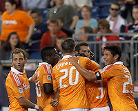 Houston Dynamo forward Will Bruin (12) celebrates his goal with teammates. In a Major League Soccer (MLS) match, the New England Revolution tied Houston Dynamo, 2-2, at Gillette Stadium on May 19, 2012.