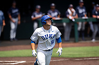Duke Blue Devils right fielder Peter Matt (51) jogs to first base against the Liberty Flames in NCAA Regional play on Robert M. Lindsay Field at Lindsey Nelson Stadium on June 4, 2021, in Knoxville, Tennessee. (Danny Parker/Four Seam Images)