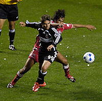 D.C. United forward Jaime Moreno (99) is defender by Chicago Fire midfielder Wilman Conde (22). The Chicago Fire defeated D. C. United 1-0 during the first leg of the MLS Eastern Conference Semifinal Series at Toyota Park in Bridgeview, IL, on October 25, 2007.