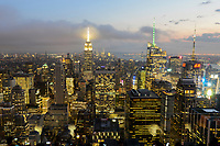 USA, New York City, Manhattan Skyline with view to Empire State Building at evening, taken from Rockefeller Center, top of the rock