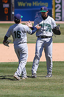 Cedar Rapids Kernels third baseman T.J. White (16) and first baseman Tyler Kuresa (22) celebrate a victory during a game against the Wisconsin Timber Rattlers on April 23rd, 2015 at Fox Cities Stadium in Appleton, Wisconsin.  Cedar Rapids defeated Wisconsin 3-0.  (Brad Krause/Four Seam Images)