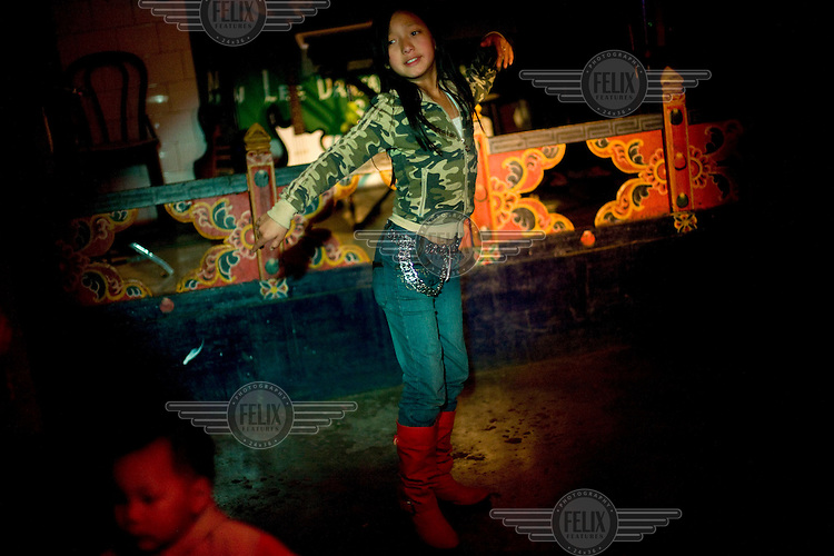 Sonam Chokey,9, dances to the Latino tunes in her mother's dance bar, the New Lee Drayang and Throkhang in Thimphu, Bhutan.