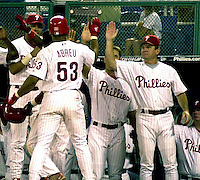 Philadelphia Phillies' Bobby Abreu, center getS a high five from his teammates and manager Larry Bowa, right following his 8th inning 2 run home run against the Florida Marlins in Philadelphia Thursday, June 28, 2001. The Phillies defeated the Marlins 8-7. (AP Photo/Brad C. Bower)