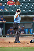 Home plate umpire Austin Jones makes a strike call during the Southern League game between the Pensacola Blue Wahoos and the Birmingham Barons at Regions Field on July 7, 2019 in Birmingham, Alabama. The Barons defeated the Blue Wahoos 6-5 in 10 innings. (Brian Westerholt/Four Seam Images)