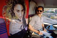 - TIR truck driver in its cabin with portrait of the Madonna singer....- autista di autocarro TIR nella sua cabina con il ritratto della cantante Madonna