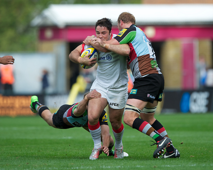 Brad Barritt of Saracens is tackled by Chris Robshaw of Harlequins during the Aviva Premiership match between Harlequins and Saracens at the Twickenham Stoop on Sunday 30th September 2012 (Photo by Rob Munro)