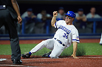 James McOwen (36) of the High Point Rockers slides into home plate during the game against the Southern Maryland Blue Crabs at Truist Point on June 18, 2021, in High Point, North Carolina. (Brian Westerholt/Four Seam Images)