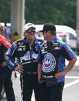 May 17, 2015; Commerce, GA, USA; NHRA funny car driver John Force (left) with Mike Neff during the Southern Nationals at Atlanta Dragway. Mandatory Credit: Mark J. Rebilas-USA TODAY Sports