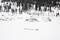 Paul Gebhardt runs along the coastline on the Bering Sea ice after leaving Elim on Tuesday during Iditarod 2008