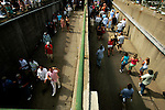 Race fans exit and enter the infield through a tunnel that goes under the racetrack at Churchill Downs in Louisville, Kentucky on May 6, 2006.  Barbaro, ridden by Edgar Prado, won the 132nd Kentucky Derby in the tenth race of the day....