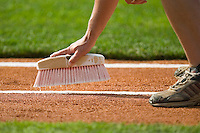 A member of the Louisville Bats grounds crew white washes the foul lines prior to the game at Louisville Slugger Field in Louisville, KY, Tuesday, June 5, 2007.