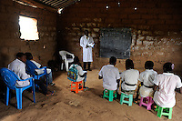 ANGOLA Kwanza Sul, village Sao Pedro, children in school, each child must bring his own plastic chair as the schools are in poor condition due to the civil war / ANGOLA Kwanza Sul, Dorf Sao Pedro, Kinder in der Schule des Dorfes, da die Schulen durch den Buergerkrieg zerstoert und ohne Inventar sind, muss jedes Kind seinen Plastik Stuhl mitbringen