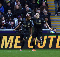 Wednesday, 01 January 2014<br /> Pictured L-R: Fernandinho of Manchester City celebrating his opening goal with team mate Matija Nastasic.<br /> Re: Barclay's Premier League, Swansea City FC v Manchester City at the Liberty Stadium, south Wales.