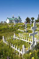 USA, Alaska, The Russian Orthodox Church and cemetery that sits on a hill above the fishing village of Ninilchik.