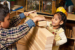 Education preschool 3-4 year olds boy and girl building with wooden blocks together