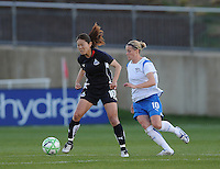 Washington Freedom midfielder Homare Sawa (10) runs whit the ball while cover by Boston Breakers midfielder Kelly Smith (10).   Boston Breakers defeated The Washington Freedom 3-1 at The Maryland SoccerPlex,  Saturday April 18, 2009.