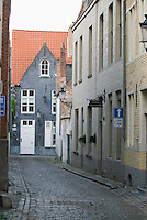 Belgium, Bruges, Narrow street with houses