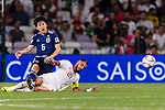 Endo Wataru of Japan (L) fights for the ball with Seyed Ashkan Dejagah of Iran (R) during the AFC Asian Cup UAE 2019 Semi Finals match between I.R. Iran (IRN) and Japan (JPN) at Hazza Bin Zayed Stadium  on 28 January 2019 in Al Alin, United Arab Emirates. Photo by Marcio Rodrigo Machado / Power Sport Images