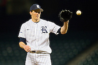 Austin Kubitza #21 of the Rice Owls catches the ball as it is throw back to him by his catcher during the game against the Texas A&M Aggies at Minute Maid Park on March 5, 2011 in Houston, Texas.  Photo by Brian Westerholt / Four Seam Images