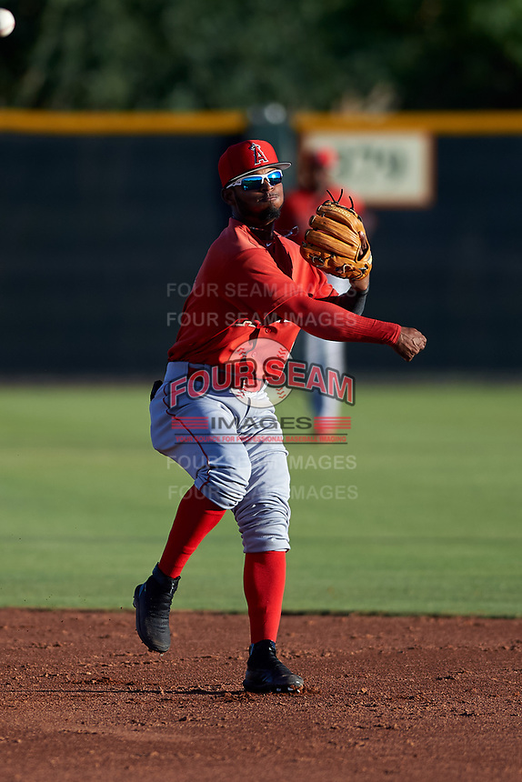AZL Angels second baseman Kendy Moya (3) throws to first base during an Arizona League game against the AZL Giants Black at the Giants Baseball Complex on June 21, 2019 in Scottsdale, Arizona. AZL Angels defeated AZL Giants Black 6-3. (Zachary Lucy/Four Seam Images)