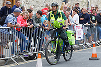 Pictured: A paramedic on his mountain bicycle on the South Parade, Tenby. Sunday 15 September 2019<br /> Re: Ironman triathlon event in Tenby, Wales, UK.