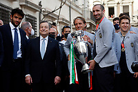 Matteo Berrettino. Giorgio Chiellini, Mario Draghi, Roberto Mancini with the cup during the visit of the Italian National team at Palazzo Chigi, where the athletes met the Italian Premier after winning the UEFA Euro 2020 cup.<br /> Rome (Italy), July 12th 2021<br /> Photo Samantha Zucchi Insidefoto